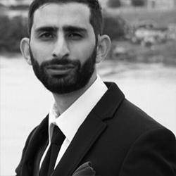 Headshot of Ayman Jaouni.