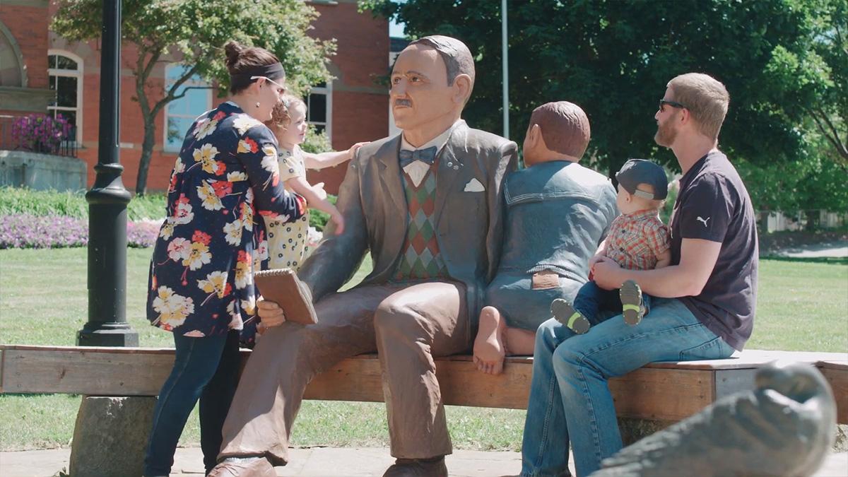 Family enjoying statues in Hampton.